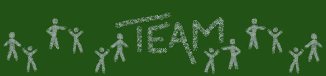 The word TEAM on a green chalkboard