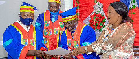 The Rector, Prof. J.-B. Muhigwa (second from the right), the Representative of the Governor, Mrs. E. Camunani, and the Vice-Rector, Prof. V. Nshombo, hand over the honorary doctorate certificate to Dr. S. Muyisa (left), representing G. Bringmann. (Photo: K. Boziana)